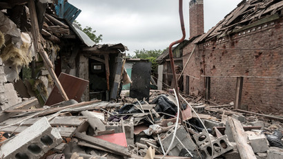 A house destroyed by an attack of the Ukrainian troops on Gorlovka, Donetsk Region.05.27.2015.(RIA Novosti / John Trast)
