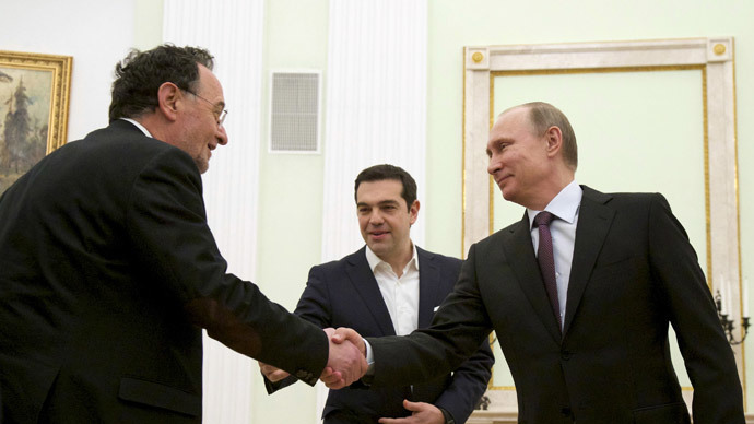 Russian President Vladimir Putin (R) shakes hands with Greek Energy Minister Panagiotis Lafazanis, as Prime Minister Alexis Tsipras stands nearby, during a meeting at the Kremlin in Moscow, April 8, 2015. (Reuters / Alexander Zemlianichenko)