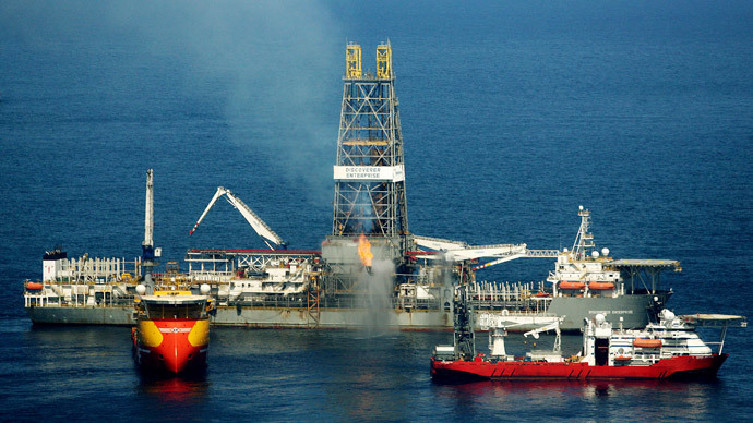 The Discoverer Enterprise drill ship uses a flare to burn natural gas and oil from an insertion pipe connected to the broken oil well under the surface at the BP oil spill site, approximately 42 miles off the coast of Louisiana in the Gulf of Mexico May 22, 2010.(Reuters / Sean Gardner )