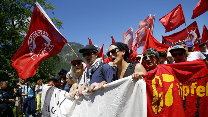 Anti-G7 ptotestors march during a demonstration in Garmisch-Partenkirchen June 7, 2015. (Reuters/Kai Pfaffenbach)
