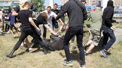 Anti-gay protesters attack a policeman during the so-called Equality March, organized by a lesbian, gay, bisexual and transgender (LGBT) community, in Kiev, Ukraine, June 6, 2015. (Reuters / Maksym Kudymets)
