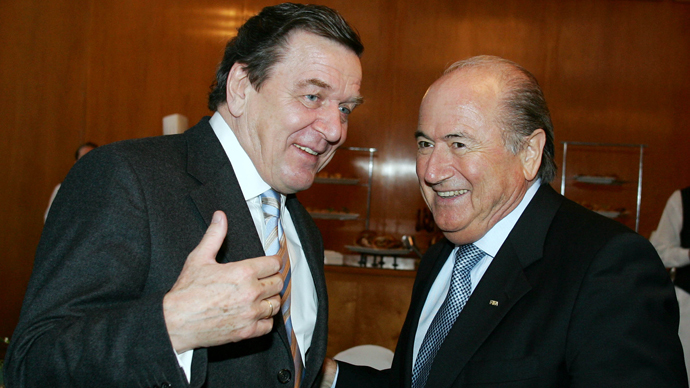 FILE PHOTO: FIFA President Sepp Blatter (R) speaks to former German Chancellor Gerhard Schroeder before the so-called Bundestag (general assembly) of the German soccer federation DFB in Leipzig December 9, 2005. (Reuters / Markus Gilliar / GES)