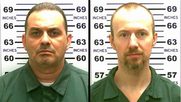 Manhunt in NY state after murderers power their way to freedom in 'elaborate escape'