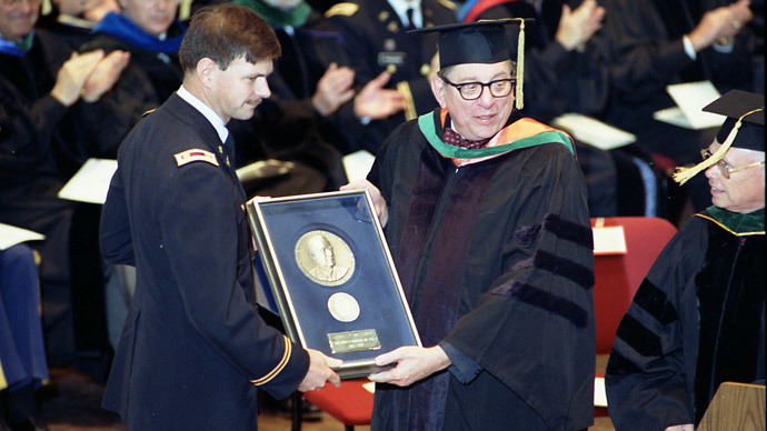 U.S. Army Medical Corps retired Lt. Colonel John Hagmann (L) is seen being presented the William P. Clements, Jr. Outstanding Uniformed Educator Award by Dr. Sam Nixon (R) during the U.S. Military's Uniformed Services University of the Health Sciences 1989 Commencement Exercises in this USUHS handout file photo taken in Washington May 20, 1989. (Reuters / Uniformed Services University of the Health Sciences)