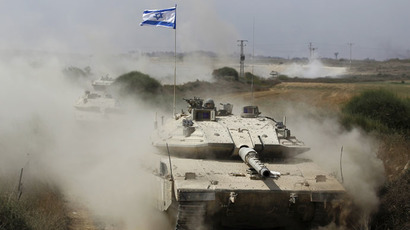An Israeli soldier rides a tank after returning to Israel from Gaza August 5, 2014. (Reuters/Amir Cohen)
