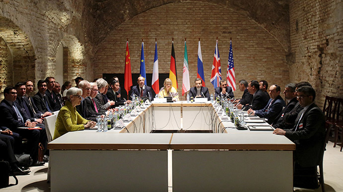 Negotiators of Iran and six world powers face each other at a table in the historic basement of Palais Coburg hotel in Vienna April 24, 2015. (Reuters/Heinz-Peter Bader)
