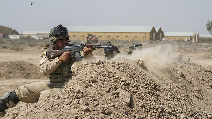 Iraqi soldiers train with members of the U.S. Army. (Reuters/U.S. Army/Sgt. Cody Quinn)