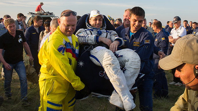 Delayed crew successfully, but belatedly returns to Earth from ISS (VIDEO)