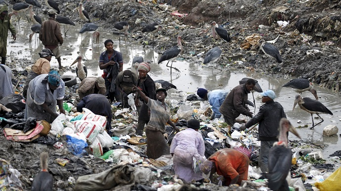 Scavengers search for recyclable materials at the Dandora dumping site on the outskirts of Kenya's capital Nairobi June 5, 2015.