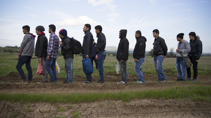 Migrants, who said they were from Syria, stand in line after being detained by the Serbian border police for having illegally entered the country from Macedonia, near the town of Presevo, Serbia (Reuters / Marko Djurica)