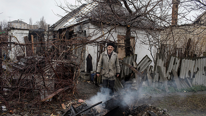 FILE PHOTO: A man stands in front of his destroyed house in the town of Debaltseve, north-east from Donetsk, March 13, 2015 (Reuters / Marko Djurica)