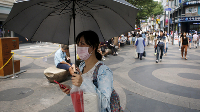 A woman wearing a mask to prevent contracting Middle East Respiratory Syndrome (MERS) walks in central Seoul, South Korea, June 15, 2015. (Reuters/Kim Hong-Ji)