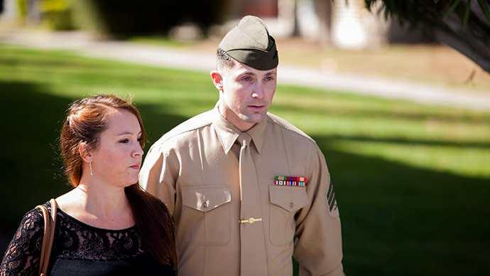 FILE PHOTO: United States Marine Sergeant Lawrence Hutchins III departs from his arraignment hearing with his wife Reyna Hutchins at Camp Pendelton, California February 13, 2014 (Reuters / Sam Hodgson)