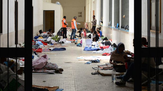 Migrants are seen on the floors in a hallway at the Vintimiglia train station in Italy, on World Refugee Day, June 20, 2015. (Reuters/Jean-Pierre Amet)