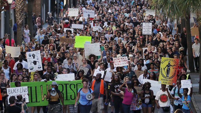 "Demonstrators in the ""March for Black Lives"" march through the streets after passing the Emanuel African Methodist Episcopal Church in Charleston, South Carolina June 20, 2015 three days after a mass shooting left people nine dead during a bible study at the church. (Reuters/Brian Snyder)"