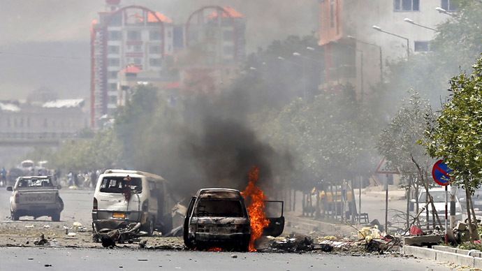 A vehicle is seen on fire after a blast near the Afghan parliament in Kabul, Afghanistan June 22, 2015. (Reuters/Mohammad Ismail)