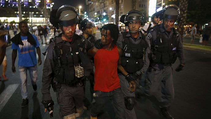 A protester, who is an Israeli Jew of Ethiopian origin, is detained by policemen during a demonstration against what they say is police racism and brutality in Tel Aviv June 22, 2015 (Reuters / Baz Ratner)