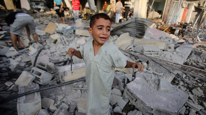 FILE PHOTO: A Palestinian boy cries as he stands in a debris-strewn street near his family's house, which witnesses said was damaged by an Israeli air strike in Rafah in the southern Gaza Strip August 26, 2014.  (Reuters / Ibraheem Abu Mustafa)