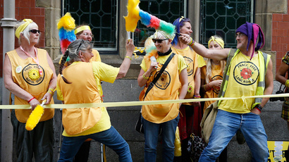 Protesters play fight with feather dusters during an anti-fracking demonstration outside County Hall in Preston, Britain, June 23, 2015. (Reuters / Phil Noble)