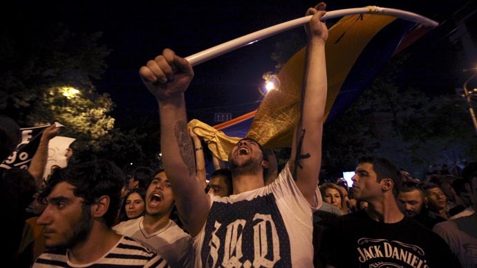 Protesters shout slogans during a rally against a recent decision to raise public electricity prices in Yerevan, Armenia, June 23, 2015. (Reuters/Hrant Khachatryan/PAN Photo)