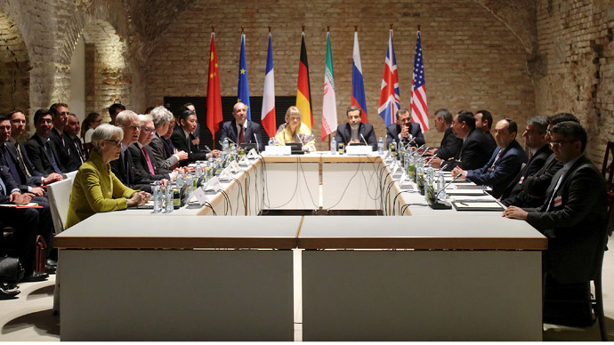 Negotiators of Iran and six world powers face each other at a table in the historic basement of Palais Coburg hotel in Vienna April 24, 2015. (Reuters / Heinz-Peter Bader)