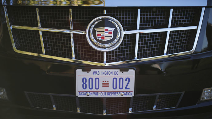 "A license plate bearing the phrase ""Taxation Without Representation"" is shown attached to the front of U.S. President Barack Obama's limousine at the White House in Washington January 20, 2013. (Reuters/Jason Reed)"
