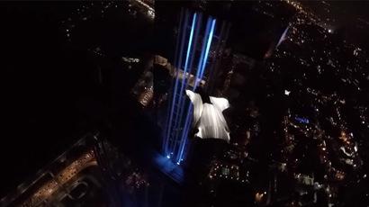 Model in glowing wingsuit lights up night skies over Panama City (VIDEO)