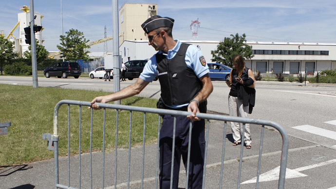 A French Gendarme blocks the access road to the Saint-Quentin-Fallavier industrial area, near Lyon, France, June 26, 2015. (Reuters / Emmanuel Foudrot)