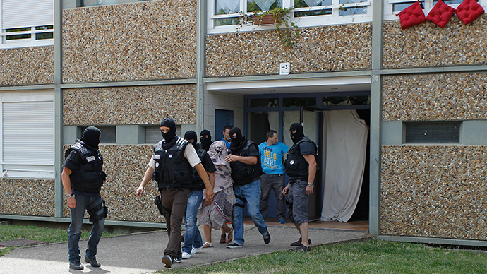 French special Police forces escort a woman from a residential building during a raid in Saint-Priest, near Lyon, France, June 26, 2015 (Reuters / Emmanuel Foudrot )
