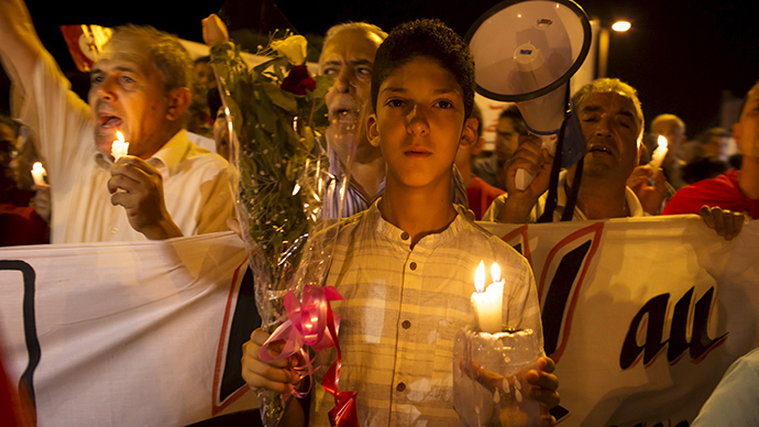 Tunisia holds vigil for horrific beach massacre victims (PHOTOS)