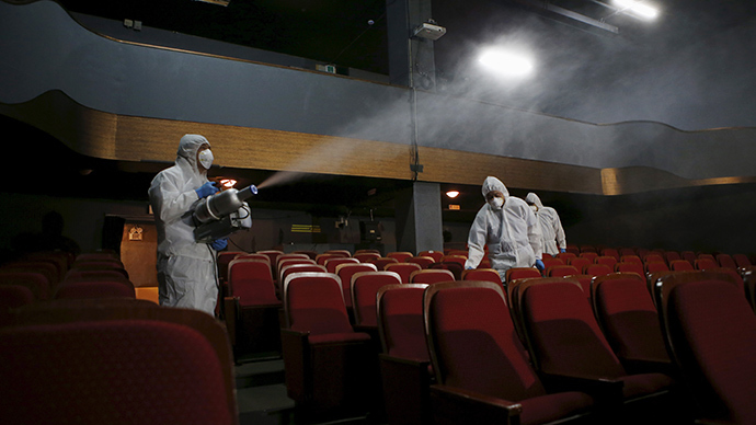 Employees from a disinfection service company sanitize the interior of a theater in Seoul, South Korea (Reuters / Kim Hong-Ji)