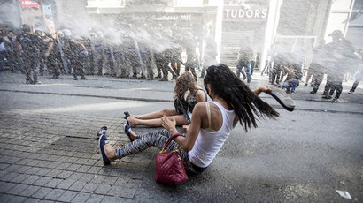 Riot police use a water cannon to disperse LGBT rights activist before a Gay Pride Parade in central Istanbul, Turkey, June 28, 2015.(Reuters / Kemal Aslan)