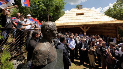People attend the opening ceremony of the restored birth house of Gavrilo Princip in Obljaj, June 28, 2014. (Reuters / Srdjan Zivulovic)
