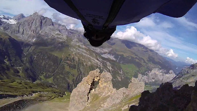 Pilot in wing suit makes 'craziest base jump ever' through tiny mountain hole (VIDEO)
