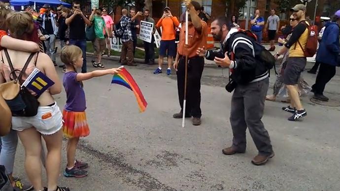 Little girl with rainbow flag vs Christian activist (VIDEO)