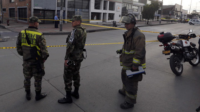 Soldiers and a firefighter stand close to the site where an explosion occurred at the office of the Porvenir pension fund in downtown Bogota July 2, 2015.(Reuters / John Vizcaino)
