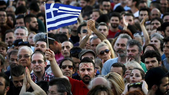 A protester sports the word 'No' in Greek on his forehead as he waves a Greek flag during an anti-austerity demonstration in Syntagma Square in Athens, Greece July 3, 2015.(Reuters / Yannis Behrakis)
