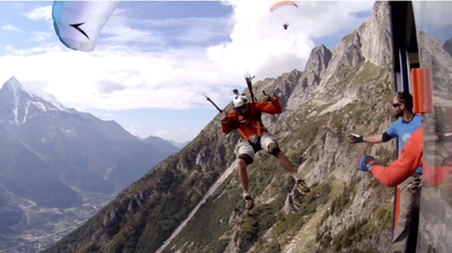 Daredevil speed-flyer jumps from Alps into moving cable car at 50mph (VIDEO)