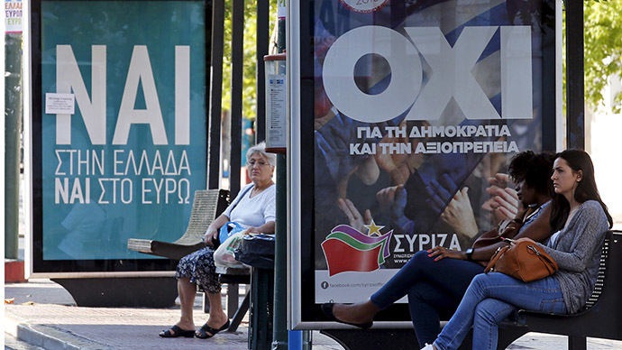 "Referendum campaign posters that reads ""No"" (R) and ""Yes"" (L) in Greek are seen on a bus stop in Athens, Greece. (Reuters / Jean-Paul Pelissier)"