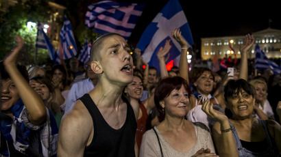 """No"" supporters celebrate referendum results on a street in central in Athens, Greece July 5, 2015.(Reuters / Marko Djurica)"