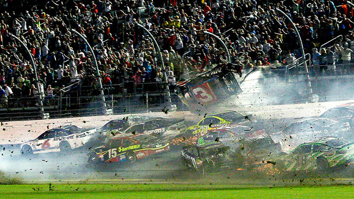 Car flies into fence in horrible NASCAR crash, driver stays alive (VIDEO)