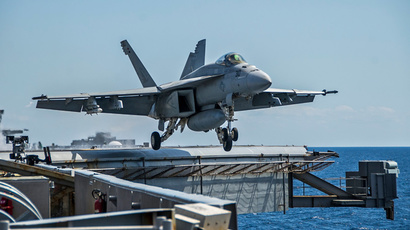 """F/A-18E Super Hornet from the Eagles of Strike Fighter Squadron (VFA) 115 being launched from the flight deck of the Nimitz-class aircraft carrier USS George Washington (CVN 73) during the two-week """"Talisman Sabre"""" exercise in the Timor Sea, off the northern coast of Australia. (AFP PHOTO / US NAVY / Mass Communication Specialist 3rd Class Chris Cavagnaro)"""