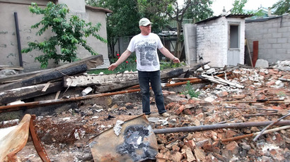 A man near a house which was destroyed by shelling by Ukrainian security forces in Oktyabrsky District in Donetsk. (RIA Novosti/Igor Maslov)