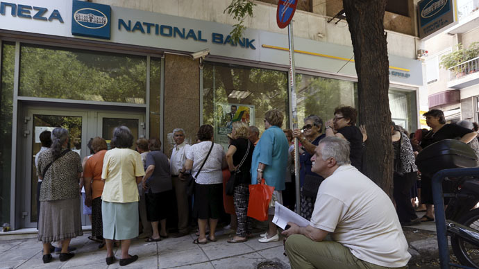 Pensioners wait in front of a National Bank branch to receive part of their pensions at an Athens neighborhood, in Greece July 9, 2015. (Reuters/Yannis Behrakis)