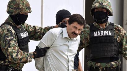 "Mexican drug trafficker Joaquin Guzman Loera aka ""el Chapo Guzman"" (C), is escorted by marines as he is presented to the press on February 22, 2014 in Mexico City. (AFP Photo/Ronaldo  Schemidt)"