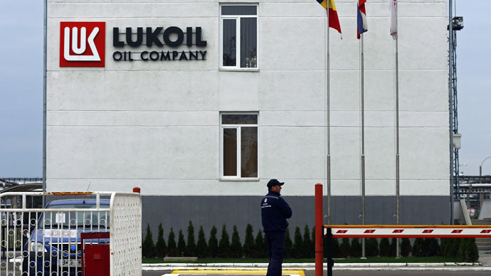 A security guard walks in front of Lukoil's refinery offices near the city of Ploiesti, in southern Romania (Reuters/Bogdan Cristel)