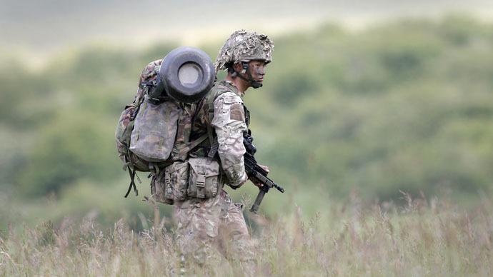 A British soldier on exercise walks across an area of Salisbury Plain, near to Westdown Camp, Britain, June 18, 2015. (Reuters/Peter Nicholls)