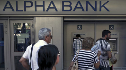 People line up at an ATM outside an Alpha Bank branch in Athens, Greece July 15, 2015. (Reuters/Yiannis Kourtoglou)