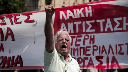 A protester shouts slogans during a rally organised by the country's biggest public sector union ADEDY marking a 24-hour strike in Athens, Greece July 15, 2015. (Reuters/Alkis Konstantinidis)