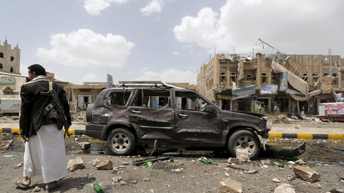 A Houthi militant stands at the site of a Saudi-led air strike in Yemen's capital Sanaa July 14, 2015. (Reuters/Khaled Abdullah)